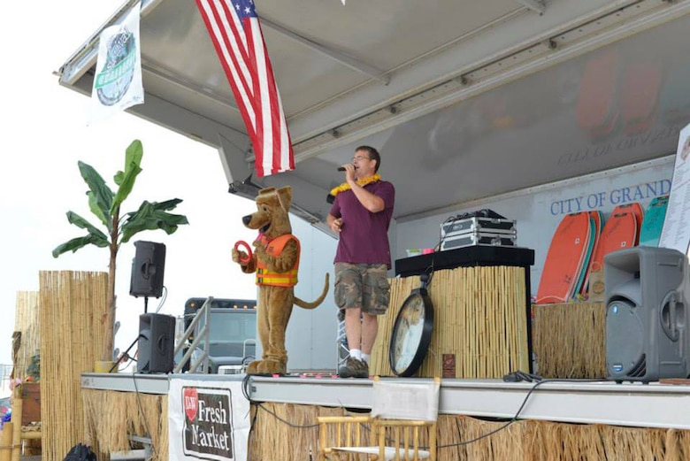 The Corps of Engineers' Bobber the Water Safety Dog makes a special appearance at this year's Beach Survival Challenge at Grand Haven State Park to stress the importance of wearing personal floatation devices while out on the water.
