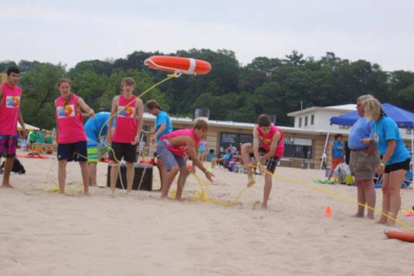 Teams participate in an obstacle course during this year's Beach Survival Challenge at Grand Haven State Park June 22.   The Beach Survival Challenge stems from a tragedy that occurred in 2002. A 17-year-old boy drowned after getting caught in a rip current in Lake Michigan, inspiring his mother to develop a fun event designed to raise awareness about rip currents and other water dangers such as pier jumping, so that swimmers may safely enjoy the beauty of Lake Michigan.