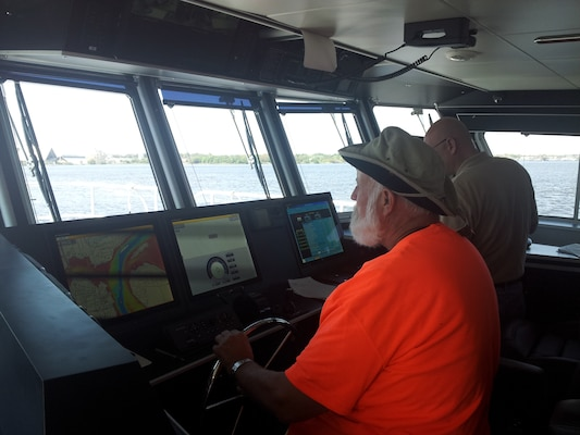 Survey technician Jack Salzer at the helm of the Florida II. Salzer was working for the Corps when the Florida first arrived in 1973