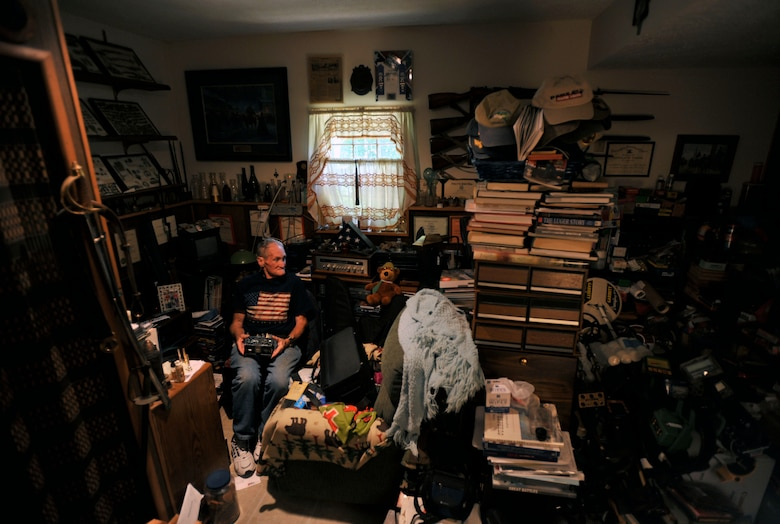 Retired U.S. Army Maj. E. Vernon Smith Jr. sits in his home in central Virginia among his collection of books, cameras and military memorabilia, July 20, 2013. Smith was stationed roughly 15 miles south of 38th parallel in Korea in support of the Korean Armistice Agreement signed July 27, 1953, ending the war between North and South Korea. (U.S. Air Force photo by Staff Sgt. Katie Gar Ward/Released)