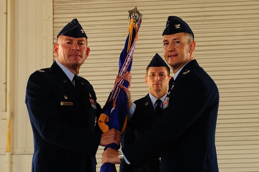 Col. Richard McComb (left), Joint Base Charleston commander, hands the guidon to Col. Michael Mongold, during the 628th Mission Support Group change of command ceremony July 18, 2013, at JB Charleston – Air Base, S.C. Mongold was commissioned in 1991 through the Air Force ROTC program at West Virginia University. He entered the Air Force as a Civil Engineer officer assigned to Altus Air Force Base, Okla. (U.S. Air Force photo/ Airman 1st Class Chacarra Neal)