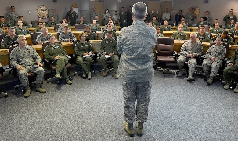 """Air Force Chief of Staff Gen. Mark A. Welsh III talks with missileers from the 90th Operations Group during a pre-departure brief at F.E. Warren Air Force Base, Wyo., July 21, 2013. Welsh, along with other base leadership, joined the brief to reiterate the important role """"Mighty Ninety"""" Airmen play in defense of the nation. He also took the time to discuss key issues impacting the service, such as sexual assault prevention, sequestration, furlough and improving communication across the service. (U.S. Air Force photo by Scott M. Ash)"""