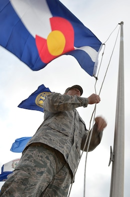 MCGHEE TYSON AIR NATIONAL GUARD BASE, Tenn. – Master Sgt. Jonathan Liermann lowers the state flag of the 38th U.S. state to join the union in 1876, Colorado, as he helps replace a display of state flags here, July 18, 2013. Every six months, Airmen from the I.G. Brown Training and Education Center meet on the parade ground to take down and replace the flags. (U.S. Air National Guard photo by Master Sgt. Kurt Skoglund/Released)