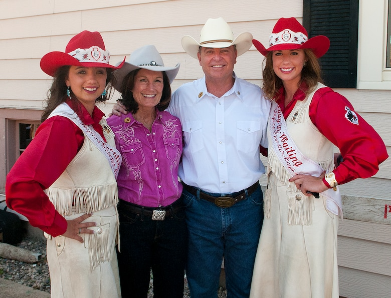 Air Force Chief of Staff Gen. Mark A. Welsh III and his wife, Betty, pose for a photograph with Chloe Pfoor, Miss Frontier; and Kaci Malmborg, her Lady-in-Waiting; prior to the start of the 117th annual Cheyenne Frontier Days parade July 20, 2013, held in downtown Cheyenne, Wyo. Welsh, who served as grand marshal for the opening parade, visited the region to participate in CFD events, but also to thank Airmen and the community for the continued service and support. (U.S. Air Force photo by R.J. Oriez)