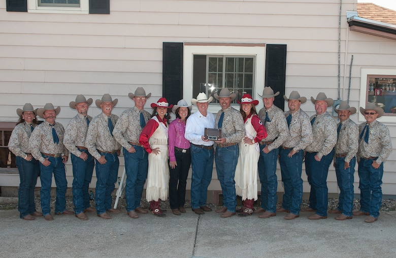 Air Force Chief of Staff Gen. Mark A. Welsh III and his wife, Betty, pose for a photograph with the 2013 Cheyenne Frontier Days committee members and Chloe Pfoor, Miss Frontier; and Kaci Malmborg, her Lady-in-Waiting; before the start of the 117th annual CFD parade July 20, 2013. Welsh, who served as grand marshal for the opening parade, visited the region to participate in CFD events, but also to thank Airmen and the community for the continued service and support. (U.S. Air Force photo by R.J. Oriez)