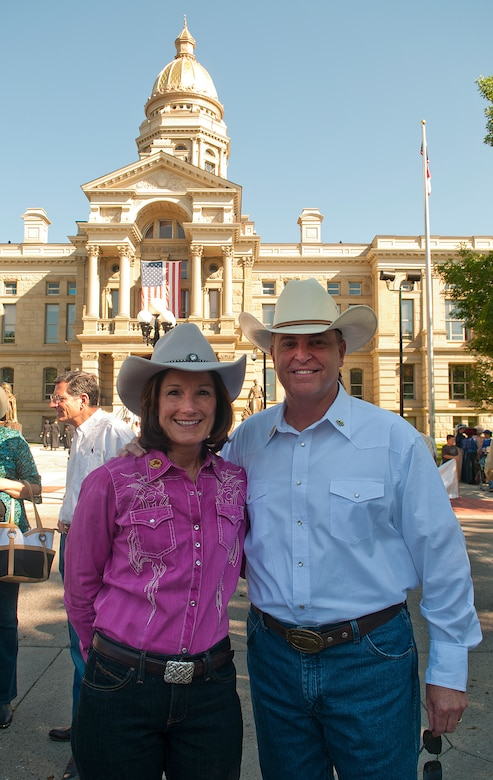 Air Force Chief of Staff Gen. Mark A. Welsh III and his wife, Betty, pose for a photograph in front of the Cheyenne, Wyo., Capitol Building prior to the start of the 117th annual Cheyenne Frontier Days parade. Welsh, who served as grand marshal for the opening parade, visited the region to participate in CFD events, but also to thank Airmen and the community for the continued service and support. (U.S. Air Force photo by R.J. Oriez)
