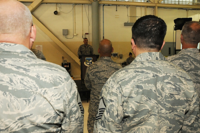 Col. John Higgins, 107th Airlift Wing Commander, addressed the men and women of the 107th.  The stand-down was a temporary stoppage of operations to focus on eliminating sexual assault in the Armed Forces, an initiative directed by the Secretary of Defense. July 21, 2013 (Air National Guard Photo/ Senior Airmen Daniel Fravel)