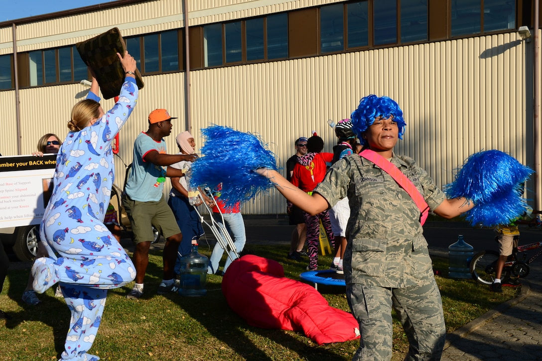 SPANGDAHLEM AIR BASE, Germany – U.S. Air Force Airmen cheer on their coworkers during a jody run July 19, 2013. The jody run event was put on by the First Four private military organization and the proceeds supported the Wounded Warrior Program and the Red Cross. (U.S. Air Force photo by Airman 1st Class Kyle Gese/Released)