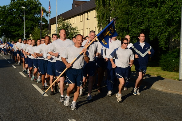 SPANGDAHLEM AIR BASE, Germany – U.S. Air Force Airmen call out cadences during a run July 19, 2013. The event was the first base-wide jody run and was put on by the First Four private military organization. (U.S. Air Force photo by Airman 1st Class Kyle Gese/Released)