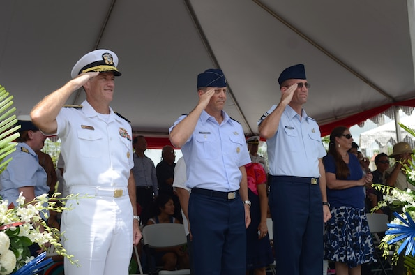 U. S. Navy Rear Adm. Tilghman Payne, Joint Region Marianas commander, Col. Jason Armagost, 36th Wing vice commander, and Chief Master Sgt. Gregory Rousey, 36th Communications Squadron superintendent, return a salute from 36th Wing Airmen as their formation passes during the 69th Liberation Day Parade July 21, 2013, in Hagåtña, Guam. Formations of active-duty service members, guardsmen and reservists, including more than 140 Airmen from the 36th Wing, led the parade down the 1.2-mile route past thousands of spectators. The parade commemorated the United States freeing the island from imperial Japan's control during the Second Battle of Guam, which began July 21, 1944, and lasted 21 days. (U.S. Air Force photo by Staff Sgt. Brok McCarthy/Released)