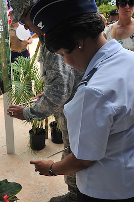 YIGO, Guam – Col. Kim Brooks, 36th Maintenance Group commander, lights a candle at the Caguas massacre memorial service in Yigo, Guam, July 17, 2013. Each lit candle signified one of the 45 native Chamorro men who were beheaded by the Japanese forces in July 1944 right before the liberation of Guam 69 years ago. (U.S. Air Force photo by Airman 1st  Class AdariusPetty/Released)