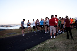 Competitors gather at the starting point of the Camp Smith 5K Grueler and wait for the horn to sound to release them onto the trails of the race route here July 20. The Grueler, a part of the Commanding Officer's Fitness Series, was open to service members, their families and the general public.