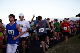 More than 150 service members, their families and other members of the community run in the Camp Smith 5K Grueler here July 20. The route, known for its scenic views and grueling ascent close 400 feet, also attracted many runners who were on Oahu for vacation.
