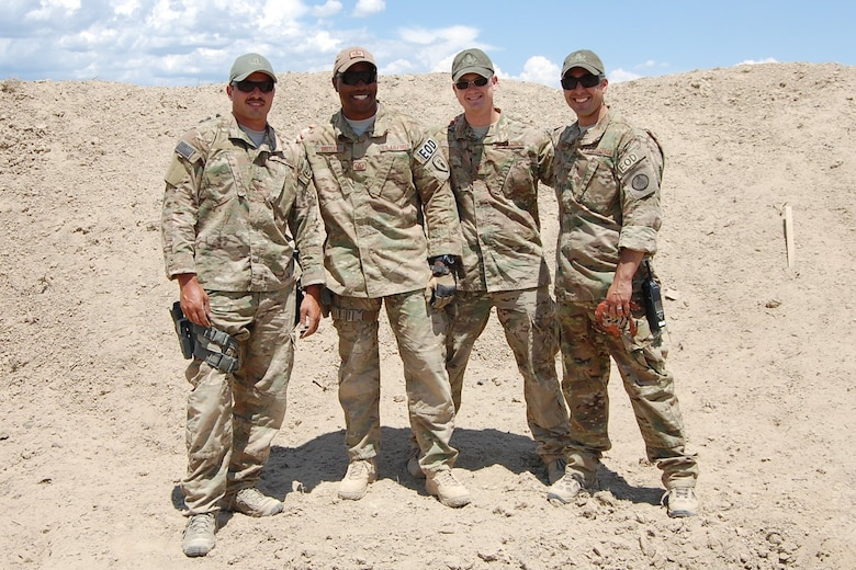 The 140th Wing's 140th Explosive Ordnance Disposal Flight members from left to right: Airman 1st Class Darrell Linkus, Staff Sgt. Christopher Broyles, Tech. Sgt. Andrew LeBeau, and Master Sgt. Richard Gibbons. (U.S. Air National Guard photo by Capt. Kinder Blacke)