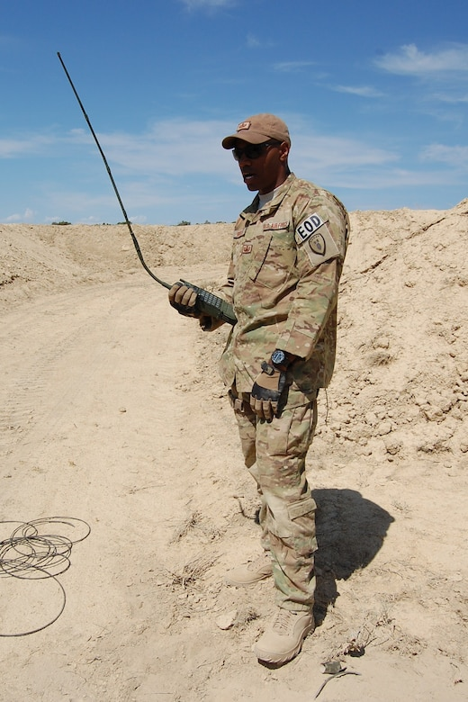 Staff Sgt. Christopher Broyles, 140th Explosive Ordnance Disposal Flight, sets up the remote firing device  for an explosive operation during the EOD Demo Day July 12, 2013 at Airburst Range, Fort Carson, Colo. (U.S. Air National Guard photo by Capt. Kinder Blacke)
