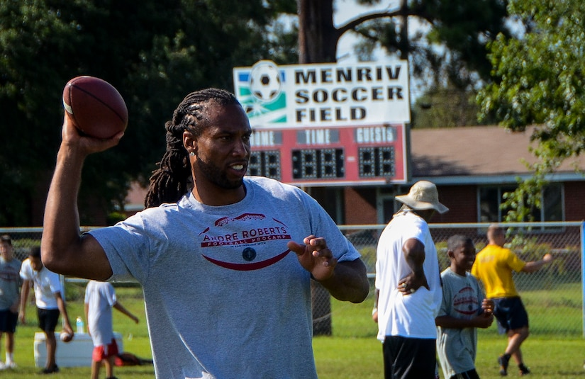 Larry Fitzgerald, Arizona Cardinals wide receiver, throws a football during the Andre Roberts ProCamp July 16, 2013, at Joint Base Charleston - Weapons Station, S.C. More than 100 base children attended the camp held July 15 and16, and participated in fundamental football drills. Small groups ensured each camper received maximum instruction from the area's top football coaches. Roberts funded the camp, enabling children to attend for free.  (U.S. Air Force photo/ Senior Airman Jared Trimarchi)