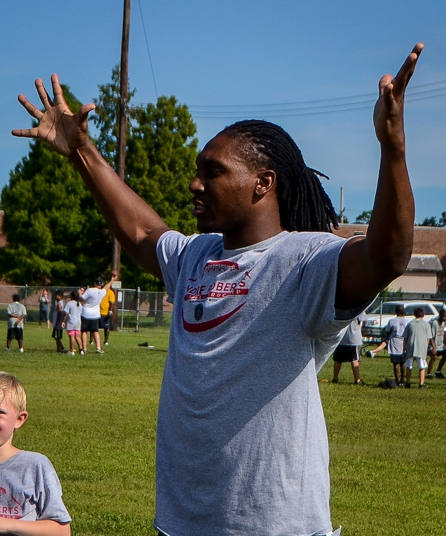 Roddy White, Atlanta Falcons wide receiver, reacts to a play during the Andre Roberts ProCamp July 15, 2013, at Joint Base Charleston - Weapons Station, S.C. More than 100 base children attended the camp held July 15 and16, and participated in fundamental football drills. Small groups ensured each camper received maximum instruction from the area's top football coaches. Roberts funded the camp, enabling children to attend for free.  (U.S. Air Force photo/ Senior Airman Jared Trimarchi)