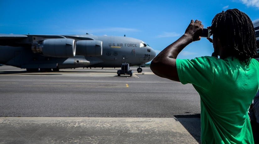 Andre Roberts, Arizona Cardinals wide receiver, takes a photo of a C-17 Globemaster III July 16, 2013, at Joint Base Charleston – Air Base. Roberts was visiting Charleston to host the Andre Roberts ProCamp July 15 and16 at the JB Charleston – Weapons Station, S.C. More than 100 base children attended the camp and participated in fundamental football drills. Small groups ensured each camper received maximum instruction from the area's top football coaches. Roberts funded the camp, enabling children to attend for free.  (U.S. Air Force photo/ Senior Airman Jared Trimarchi)