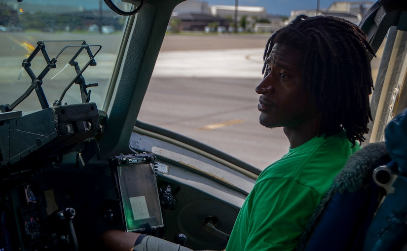 Andre Roberts, wide receiver for the NFL's  Arizona Cardinals, sits in the flight deck of a C-17 Globemaster III July 16, 2013, at Joint Base Charleston – Air Base. Roberts was visiting Charleston to host the Andre Roberts Pro Camp July 15 and16 at the JB Charleston – Weapons Station, S.C. More than 100 base children attended the camp and participated in fundamental football drills. Small groups ensured each camper received maximum instruction from the area's top football coaches. Roberts funded the camp, enabling children to attend for free.  (U.S. Air Force photo/ Senior Airman Jared Trimarchi)
