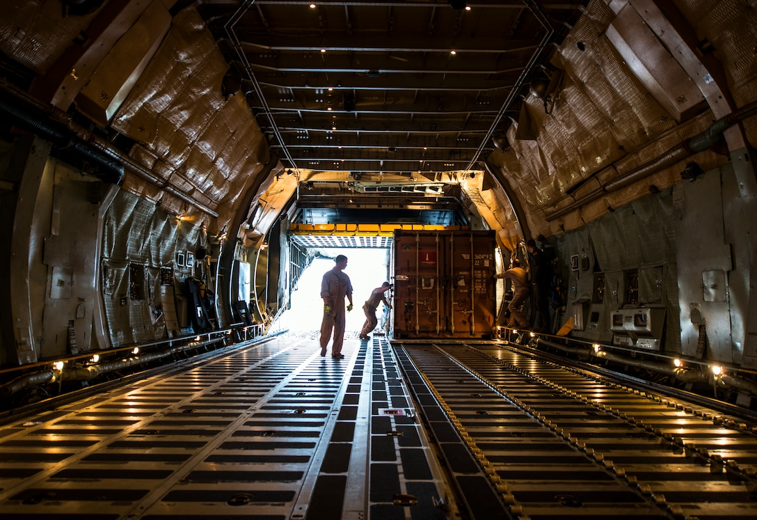 West Virginia Air National Guard Airmen from the 167th Airlift Wing, Martinsburg, W. Va., load cargo onto a C-5 Galaxy July 22, 2013, at Joint Base Charleston, S.C. The cargo is being used to assist operation Enduring Freedom. The C-5 is one of the largest aircraft in the world and the largest airlifter in the Air Force inventory. (U.S. Air Force photo/ Senior Airman Dennis Sloan)