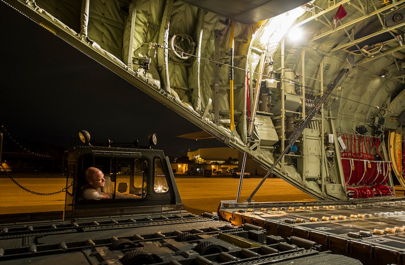 Staff Sgt. Kenneth Hulsey, 437th Aerial Port Squadron ramp service supervisor, operates a K-loader during an early morning cargo load July 23, 2013, at Joint Base Charleston - Air Base, S.C. The C-130J-30 was loaded with rations and supplies bound for Bogota. The C-130J-30 is a stretch version of the C-130J, a proven, highly reliable and affordable airlifter. The C-130J-30 adds 15 feet to the fuselage, increasing usable space in the cargo compartment. (U.S. Air Force photo/ Senior Airman George Goslin)