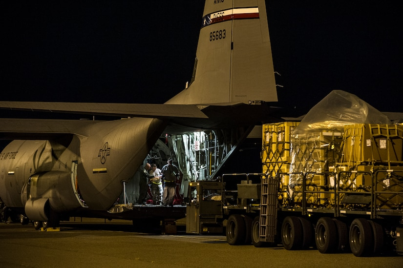 Staff Sgt. Kenneth Hulsey, 437th Aerial Port Squadron ramp service supervisor, drives a K-loader towards a C-130J-30 from Dyess Air Force Base, Texas, during an early morning cargo load July 23, 2013, at Joint Base Charleston - Air Base, S.C. The C-130J-30 was loaded with rations and supplies bound for Bogota. The C-130J-30 is a stretch version of the C-130J, a proven, highly reliable and affordable airlifter. The C-130J-30 adds 15 feet to the fuselage, increasing usable space in the cargo compartment. (U.S. Air Force photo/ Senior Airman George Goslin)