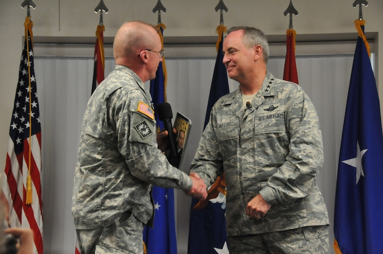Air Force Chief of Staff Gen. Mark A. Welsh III shakes hands with Maj. Gen. K. Luke Reiner, Wyoming's adjutant general, after addressing Airmen of the 153rd Airlift Wing, Wyoming Air National Guard, during an Airman'scall July 19, 2013 in Cheyenne, Wyo. Welsh thanked the 153rd AW, discussed Air Force priorities and answered questions from the audience. (U.S. Air National Guard photo by Senior Airman Nichole Grady)
