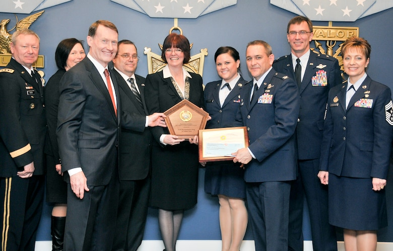 Department of Defense and National Guard leaders present the 147th Reconnaissance Wing Airman and Family Readiness Program office with the 2012 DoD Reserve Family Readiness Award for the Air National Guard during a ceremony at the Pentagon on March 1, 2013.