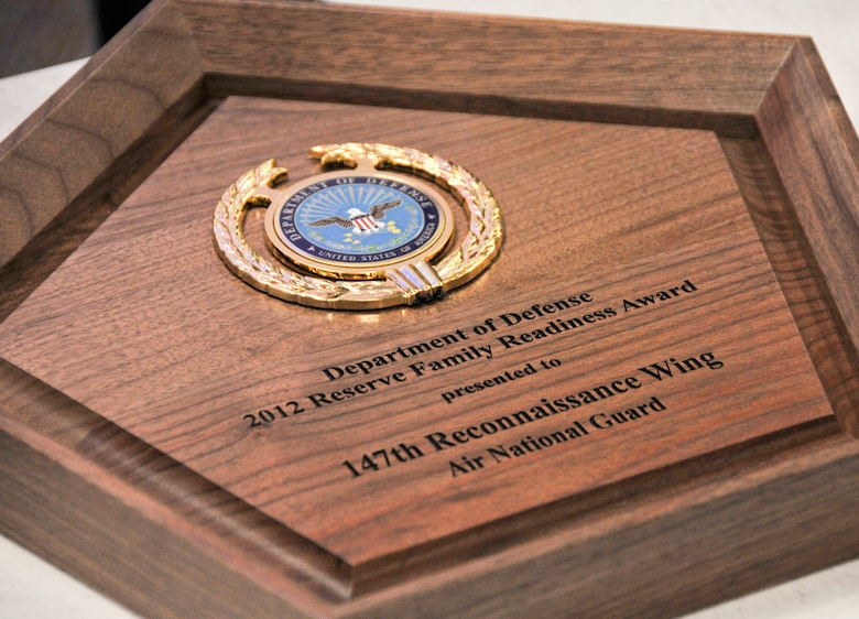 The plaque awarded to the 147th Reconnaissance Wing Airman and Family Readiness Program Office during the 2012 Department of Defense Reserve Family Readiness Award Ceremony at the Pentagon on March 1, 2013. The 147th RW Family Readiness Office was named best in the Air National Guard for 2012. (National Guard Photo by MSgt Sean Cowher)
