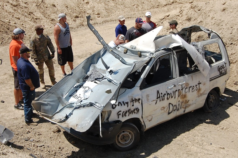 Visitors assess the damage done to a vehicle by a hydraulic explosive device during the EOD Demo Day July 12, 2013 at Airburst Range, Fort Carson, Colo. (U.S. Air National Guard photo by Capt. Kinder Blacke)