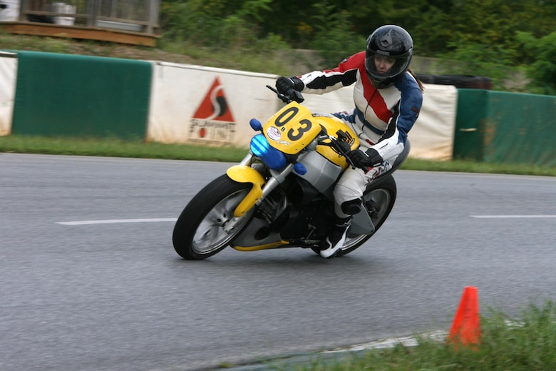 SUMMIT POINT, W. Va. – Senior Master Sgt. Marcy Broadway takes a turn at a motorcycle track in West Virginia September 2012 with her Buell 998cc Lightning streetfighter. (Courtesy photo/Released)