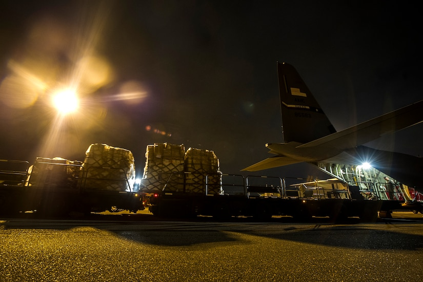 Cargo is loaded onto a C-130J-30 from Dyess Air Force Base, Texas, during an early morning cargo load July 23, 2013, at Joint Base Charleston - Air Base, S.C. The C-130J-30 was loaded with rations and supplies bound for Bogota. The C-130J-30 is a stretch version of the C-130J, a proven, highly reliable and affordable airlifter. The C-130J-30 adds 15 feet to the fuselage, increasing usable space in the cargo compartment. (U.S. Air Force photo/ Senior Airman George Goslin)