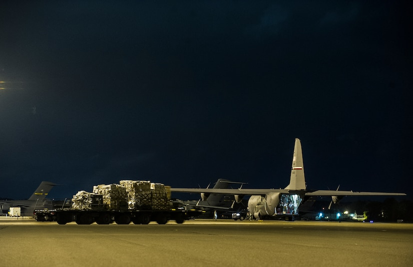 A C-130J-30 from the 317th Airlift Group, Dyess Air Force Base, Texas, waits to be loaded during an early morning cargo load July 23, 2013, at Joint Base Charleston - Air Base, S.C. The C-130J-30 was loaded with rations and  supplies bound for Bogota. The C-130J-30 is a stretch version of the C-130J, a proven, highly reliable and affordable airlifter. The C-130J-30 adds 15 feet to the fuselage, increasing usable space in the cargo compartment. (U.S. Air Force photo/ Senior Airman George Goslin)