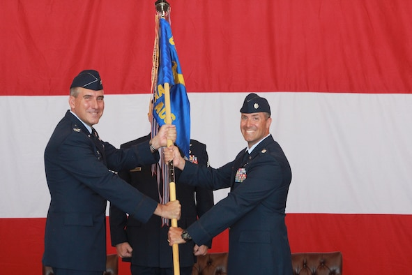 Col. John J. Cooper, Commander, 552nd Operations Group passes the guidon for the 960th Airborne Air Control Squadron to Lt. Col. Keven P. Coyle. Previously, Lt. Col. Coyle was the Director of Operations of the 968th Expeditionary Air Control Squadron, Al Dhafra AB, United Arab Emirates. Lt. Col. Coyle assumes command of the 960th from Lt. Col. Michael S. Smith who is heading to up to the 552nd Operations Group as Deputy Group Commander. (Air Force photo by Master Sgt. Joel D. Andren)