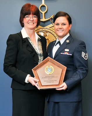 Ms. Monalisa Norton, 147th Reconnaissance Wing Airman and Family Readiness Program Manager, and Staff Sgt. Holly Yeagley, assistant to Ms. Norton, were presented with a plaque during the Department of Defense Reserve Family Readiness Awards ceremony at the Pentagon March 1, 2013. Ms. Norton and the 147th RW Family Readiness office were named as the best in the Air National Guard for 2012. (National Guard photo by Master Sgt. Sean Cowher)