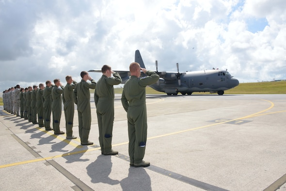 Members of the 17th Special Operations Squadron salute as the aircrew of MC-130P Combat Shadow 69-5825 completes a final taxi before the aircraft's departure from Kadena Air Base, Japan, July 17, 2013, to Davis-Monthan Air Force Base, Ariz.  The aircraft will retire after 44 years of active service and more than 18,000 flying hours.  (U.S. Air Force photo by Tech. Sgt. Kristine Dreyer/Released)
