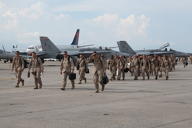 Marines with Marine Aviation Logistics Squadron 31, make their approach to the Marine fighter Attack Squadron 122 hangar in order to be reunited with their families after a six-month deployment, July 18. during the deployment, the MALS-31 detachment was an augment with MALS-40 in support of Operation Enduring Freedom.