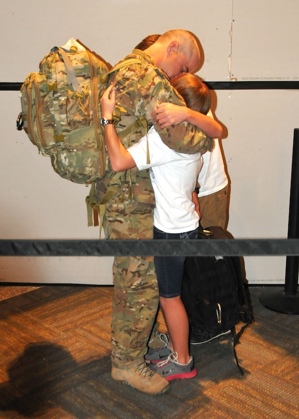 Senior Master Sgt. Kurt Trowbridge, 120th Security Forces Squadron member, is greeted and hugged by family members at the Great Falls International Airport on July 16. He had just returned to Great Falls after completing a six-month overseas deployment in support of Operation Enduring Freedom. (U.S. Air Force photo/Senior Master Sgt. Eric Peterson)