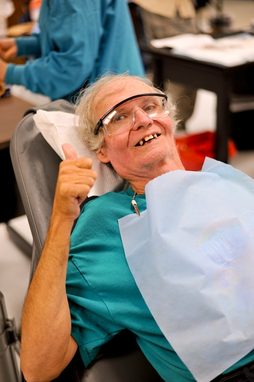 Edward Hicks, a resident of nearby Dresden, Tenn., shows his excitement before his second dental procedure in two weeks. Hicks visited Hope of Martin all but two days over the two-week event in order to see providers. On top of receiving a comprehensive optical exam and a new pair of glasses, also produced on-site, Hicks also had multiple dental procedures which included the extraction of 30 teeth badly in need of repair. Air National Guard photo by Master Sgt. Beth Holliker (Released).