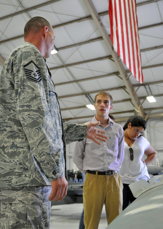 Master Sgt. Christopher Rasco, a load standardization team chief assigned to the 355th Maintenance Operations Squadron, discusses the Joint Direct Attack Munition GBU-31 bomb with graduate and doctoral engineering students from Brazil during a visit to Davis-Monthan Air Force Base, July 24. The students were in Tucson, Ariz., visiting the nearby Raytheon Company as part of Brazil's Science Without Borders program and requested the opportunity to visit D-M.  The GBU-31 is the largest version of the JDAM weighing in at approximately 2,000 pounds. (U.S. Air Force photo/Capt. Jonathan Simmons)