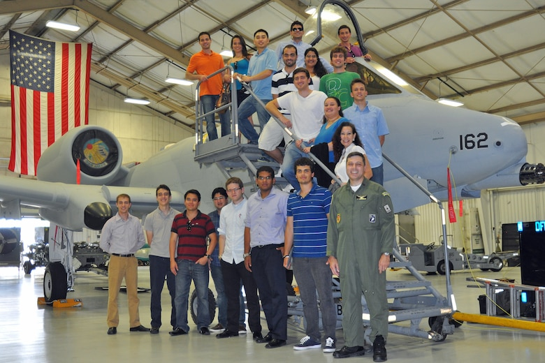 Graduate and doctoral engineering students from Brazil pose for a picture in front of a U.S. Air Force A-10 Thunderbolt II with Col. Paulo Vasconcellos, Brazilian Air Force liaison officer to Headquarters Twelfth Air Force (Air Forces Southern), during a tour of Davis-Monthan Air Force Base, July 24. The students were in Tucson, Ariz., visiting the nearby Raytheon Company as part of Brazil's Science Without Borders program and requested the opportunity to visit D-M.  The A-10 is a close air support aircraft that has proven invaluable to the United States and its allies in operations including Desert Storm, Southern Watch, Provide Comfort, Desert Fox, Noble Anvil, Deny Flight, Deliberate Guard, Allied Force, Enduring Freedom and Iraqi Freedom. (U.S. Air Force photo/Capt. Jonathan Simmons)