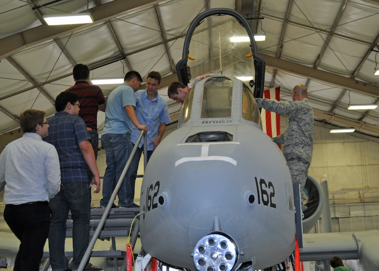 Graduate and doctoral engineering students from Brazil get an up-close look at the U.S. Air Force A-10 Thunderbolt II during a tour at Davis-Monthan Air Force Base, July 24. The students were in Tucson, Ariz., visiting the nearby Raytheon Company as part of Brazil's Science Without Borders program and requested the opportunity to visit D-M.  The A-10 is a close air support aircraft that has proven invaluable to the United States and its allies in operations including Desert Storm, Southern Watch, Provide Comfort, Desert Fox, Noble Anvil, Deny Flight, Deliberate Guard, Allied Force, Enduring Freedom and Iraqi Freedom. (U.S. Air Force photo/Capt. Jonathan Simmons)