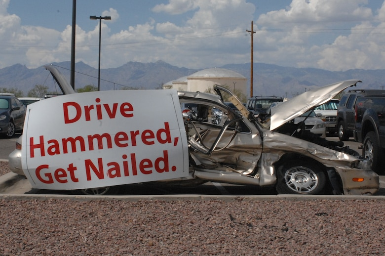 A car sits in the 755th Aircraft Maintenance Squadrons parking lot representing a drunk driving accident at Davis-Monthan Air Force Base, Ariz., July 15, 2013. The car is part of the squadron's campaign to bring awareness to the effects of drunk driving and help prevent similar incidents. (U.S. Air Force photo by Airman 1st Class Betty Chevalier/Released)