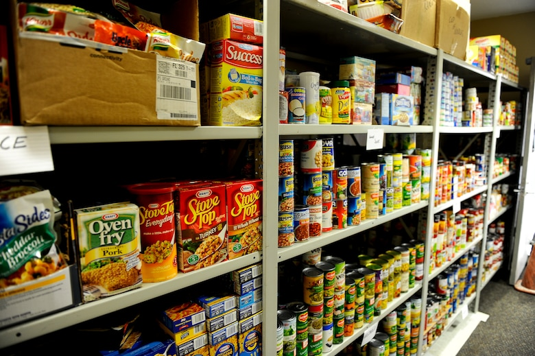 More than 3,000 pounds of non-perishable food sits on the shelves of the base food pantry located in the same building as the Airman's Attic on Hurlburt Field, Fla., July 24, 2013. Anyone needing access to the food pantry should seek their first sergeants assistance. (U.S. Air Force photo by Airman 1st Class Jeffrey Parkinson)