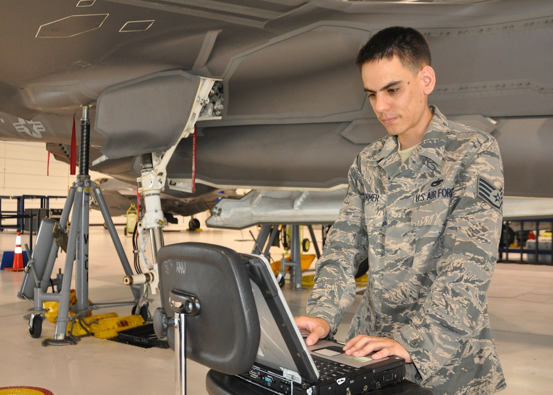 Staff Sgt. Matthew Stormer, dedicated F-35A Lightning II crew chief, 33rd Fighter Wing, Eglin Air Force Base, Fla., reviews joint technical data while performing tasks to maintain the joint strike fighter July 25, 2013. The aircraft is undergoing scheduled routine maintenance to include a landing-gear functional check. Eglin is the heart of F-35 training worldwide for the Air Force, Marines, Navy and international partner operators and maintainers of the Lightning II. (U.S. Air Force photo/ Maj. Karen Roganov)