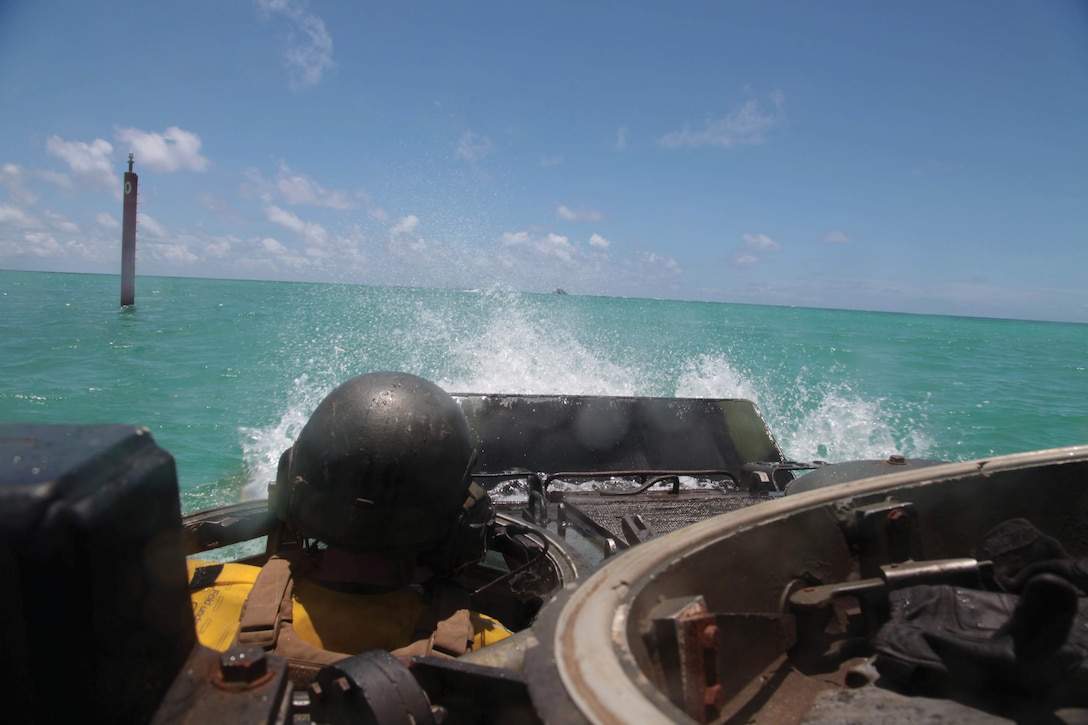 Lance Cpl. Zachary A. Chastain operates an assault amphibious vehicle during a training exercise July 15 near Camp Schwab. CAB provides 3rd Marine Division with engineers, assault amphibious vehicle support, and light-armored reconnaissance, motor transportation, heavy-equipment and communications capabilities, as well as, chemical, biological, radiological and nuclear defense assets all within one unit. Chastain is an assault amphibious vehicle crewman with AAV Company, CAB, 3rd Marine Division, III MEF.
