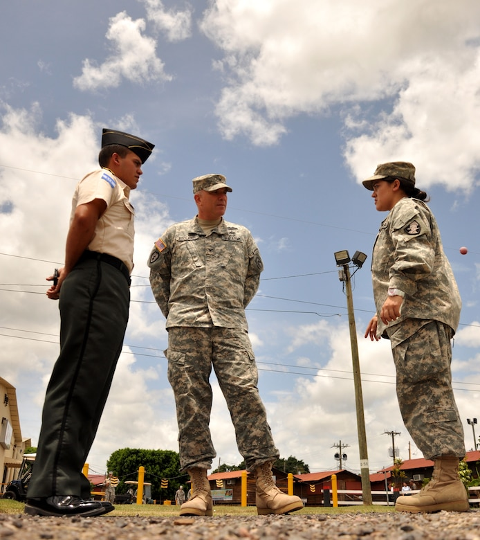 U.S. Army Col. Thomas D. Boccardi, Joint Task Force-Bravo commander, center, speaks to Cadet Beatriz Martorell, a West Point junior, and 2nd Lt. Isaac Martorell, West Point graduate and brother of Beatriz,  here about their future aspirations July 24, 2013. Beatriz had the unique opportunity to return to her home country and perform Cadet Leadership Training at the Honduran Presidential House as well at Soto Cano Air Base. (Photo released by U.S. Air Force Staff Sgt. Jarrod R. Chavana)