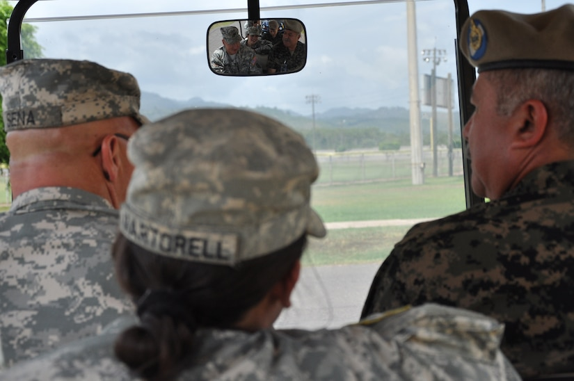 U.S. Army Col. John E. Cena, Joint Task Force Bravo Army Support Activity commander, left, gives Honduran Brig. Gen. Diaz (U.S. four-star equivalent) Andres Felipe Diaz Lopez, Presidential Honor Guard commander, right, a base tour as Cadet Beatriz Martorell, West Point junior, center, translates July 24, 2013. Martorell had the unique opportunity to return to her home country and perform Cadet Leadership Training at the Honduran Presidential House as well at Soto Cano Air Base. (Photo released by U.S. Air Force Staff Sgt. Jarrod R. Chavana)