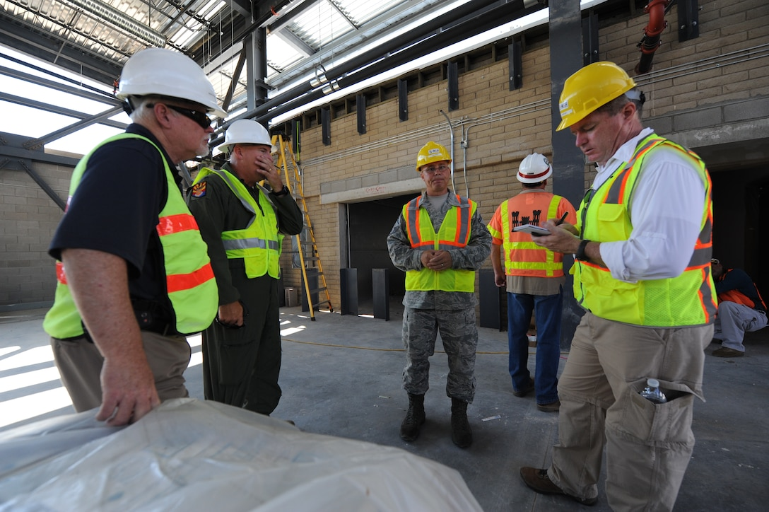 An Arizona Republic reporter takes notes as members of the F-35 construction team show him projects underway on base. (U.S. Air Force photo/Airman 1st Class Devante Williams)
