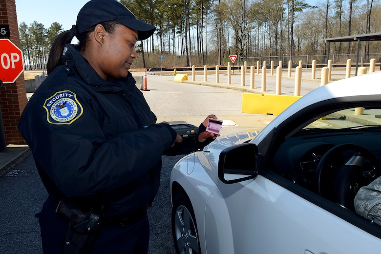 Ms. Veronica Dennis, security forces personnel with the 169th Security Forces Squadron at McEntire Joint National Guard Base, S.C., checks ID cards at the main gate entrance using the Defense Biometric Identification System scanner, March 28, 2013. (U.S. Air National Guard photo by Tech. Sgt. Caycee Watson/Released)